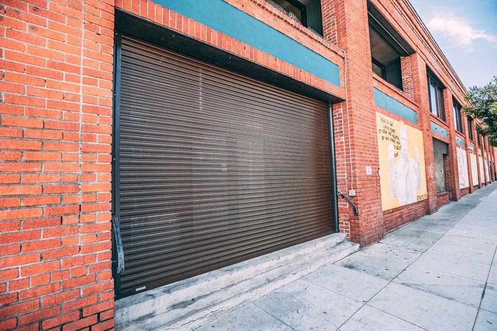 Commercial security door installed for brick building