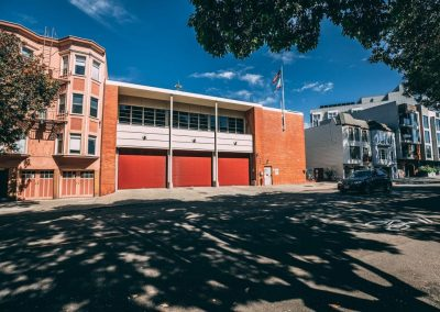 Fire house in San Francisco with new red steel rolling doors