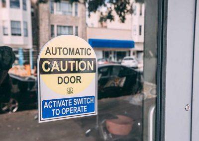 Automatic caution door sticker