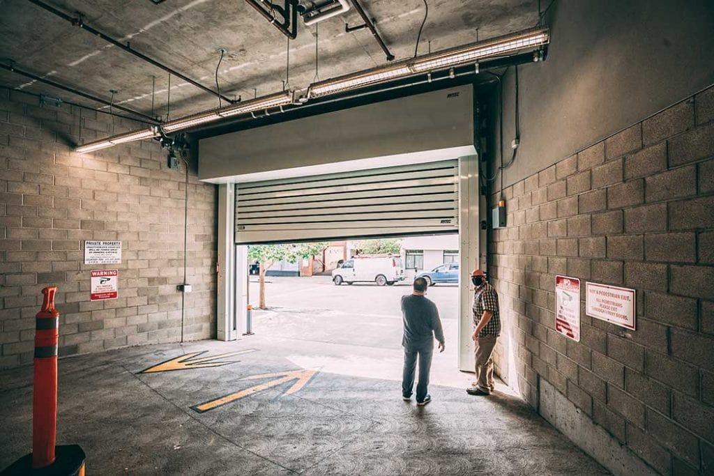 Union Door team members standing behind a newly installed overhead door