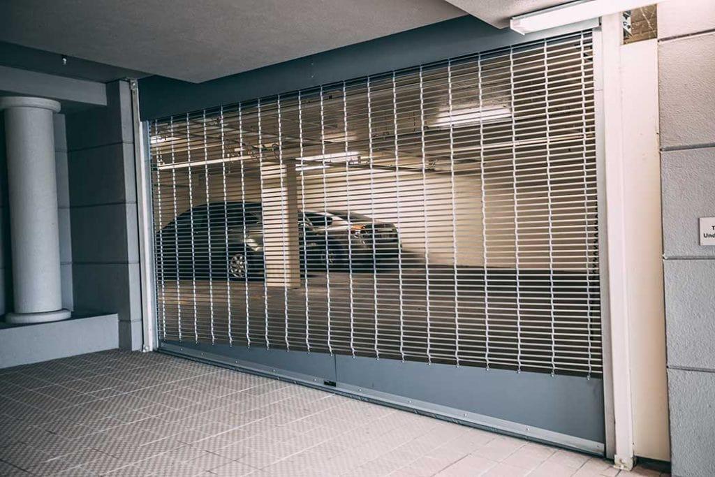 Custom slanted rolling gate to parking garage