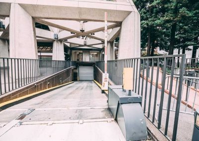 Entrance to underground parking garage with a metal rolling door