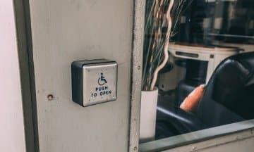 Automatic ADA compliance door button