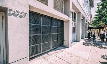 Steel commercial doors installed in front of building