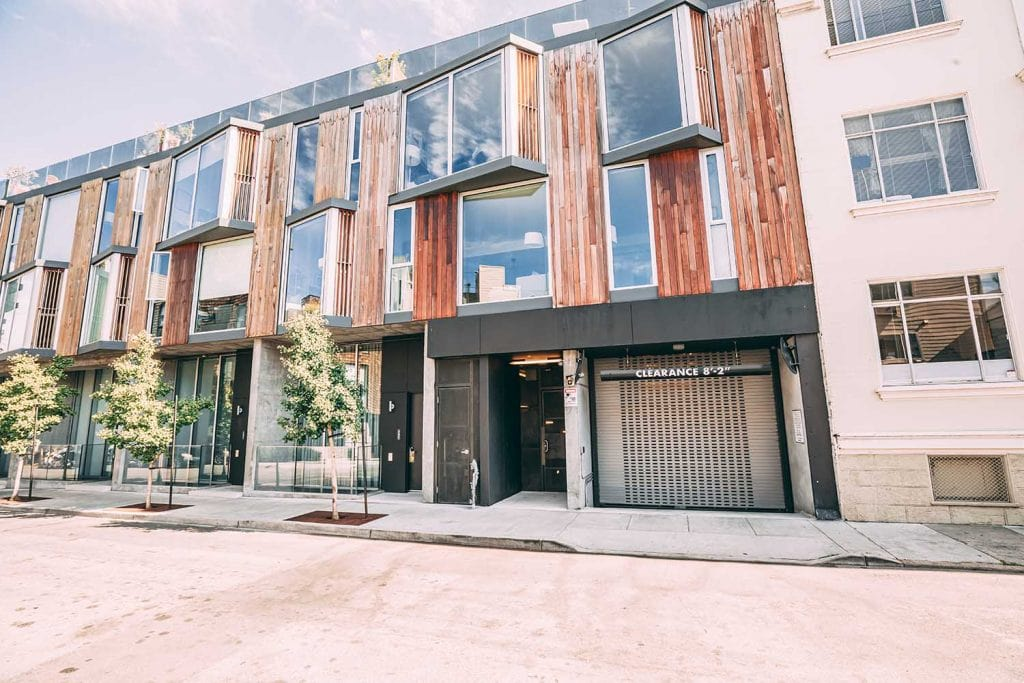 Apartment buildings in San Francisco with new rolling grille door to parking lot