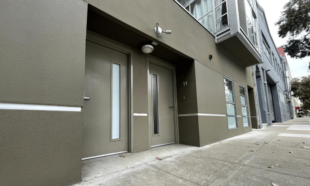 Yellow entrance door installed by Union Door